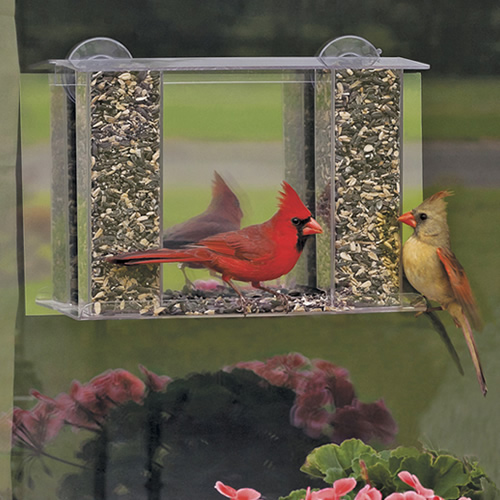 Watch birds dine undisturbed at your windowOur popular window feeder comes with one-way mirror film. Apply the 8 x 14 inch sheet of mirror film inside your window. The reflective film allows you to watch your birds—and prevents birds from seeing you! Easy to remove or reposition, without any sticky residue. Includes two heavy duty suction cups to firmly attach the feeder to your window. Try a different seed in each hopper. Clear plastic with removable roof. The seed stays dry for fewer refills. 11-1/2 x 3-1/2 x 8-1/2 inches tall.    Holds 2 lbs. of any seed Attract birds to your window, without them seeing you Features two clear plastic hoppers for viewing the seed levels Easy to clean with filling from the top Made in the USA, available exclusively at Duncraft