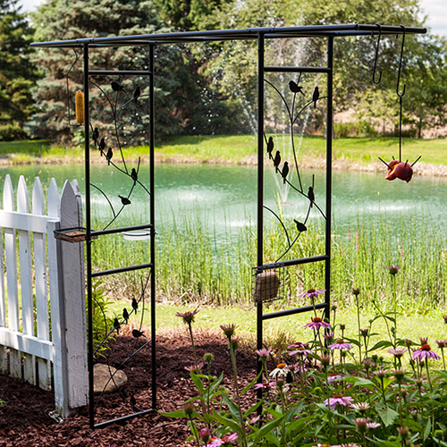 This arbor is also a feeding stationCreate a welcoming entrance to your garden and watch more birds in one area. This arbor and feeding station features a decorative bird motif along the sides. Great for hanging a variety of plants and feeders! You receive the arbor with the following bird feeding accessories: four assorted S-hooks for hanging your own feeders: 6 inch, 8 inch, 10 inch and 12 inch, one fruit skewer feeder, one corn on the cob or seed cylinder feeder, one clear acrylic birdbath dish, one mesh mealworm tray feeder and one suet cage. Assembly required. Measures 48 inches wide between the two sides. This arbor feeding station measures 84 x 16 x 84 inches tall overall.     Decorative garden arbor & feeding station Attract more birds to one area for easy viewing Features fruit skewer, birdbath, suet feeder & other accessories Includes four stakes to hold this station in the ground