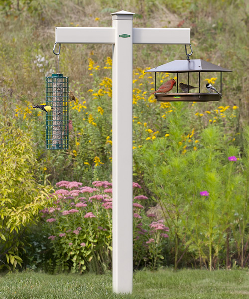 A revolutionary bird feeding station built for strength and durability Dare to dream the possibilities of options with our exclusive easy-to maintain heavy duty vinyl design that never needs sanding, painting or staining. Hang bird feeders, bird houses, or flower baskets on the two heavy duty arms.     Can be installed in minutes, in almost any feeding area for years of enjoyment. All hardware included, as well as our heavy duty 4 x 4 inch twister ground auger that goes 20 inches into the ground for stability.    This premium PVC post will never fade, crack, or rot, made in the USA. Total height above ground is 72 inches. Beige, measures 4 x 4 x 84 inches, 14 inch arms. Feeders shown are not included. Made (with love) in the USA. 2 Day express shipping is not available for this item.